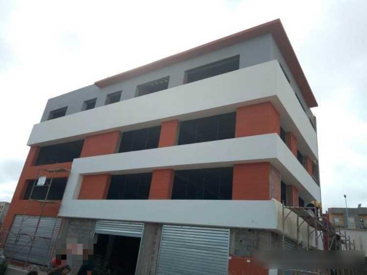 Vente Bâtiment, immeuble, local commercial idéal pour café, restaurant, club de sport au Maroc, dans une zone industrielle